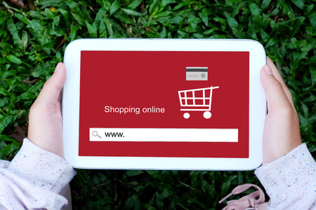 ebuy: Hand holding tablet with www. on search bar screen background, on line shopping ,business, E-commerce, technology and digital Stock Photo