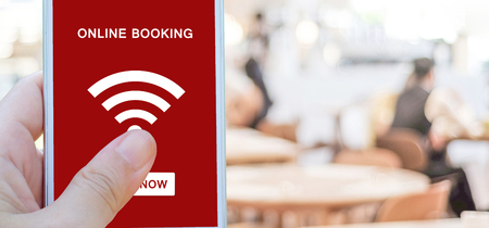 Online booking over blur restaurant background, banner with copy space, food and drink, restauant reservation Stock Photo
