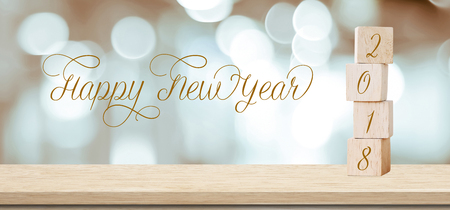 Wooden cubes with 2018 and happy new year over blur bokeh background, banner with copy space for text, new year greeting card template Stock Photo