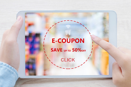 E-coupon, discount coupon on digital tablet screen to get the grocery shopping on line promotion, on line shopping, digital marketing, business and technology, lifestyle concept
