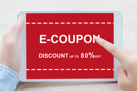 E-coupon, discount coupon on tablet screen to get the shopping on line promotion, on line shopping, digital marketing, business and technology, lifestyle concept