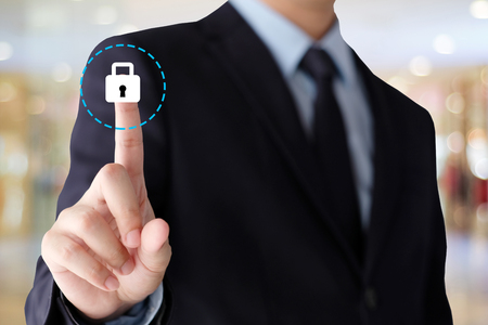 Businessman hand touching  cyber security icon over blur background with copy space,business and technology background, banner