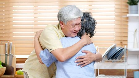 Senior asian couple at home, Elderly asia woman and man consoling and comforting each other from depressed emotion while standing in kitchen at home living room, Asia old retirement people lifestyle Stock fotó - 149399042