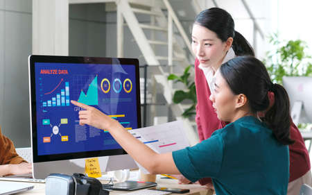 Asian women discussing about business plan, Asia female team analyze business data at office