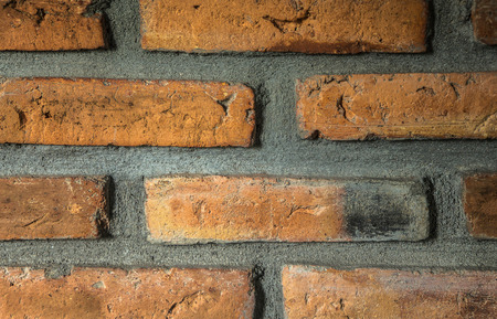 solidity: Red brick wall close up Stock Photo
