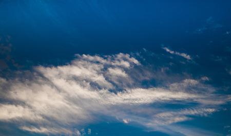 dark sky: Dark blue sky with clouds