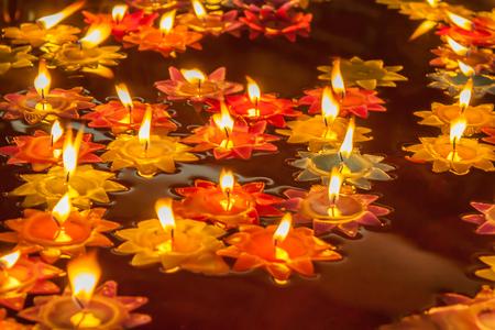 prayer candles: lit prayer candles float on vegetable oil