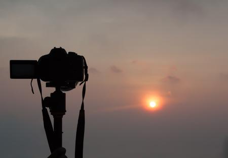 capturing: DSLR Camera capturing sunrise view