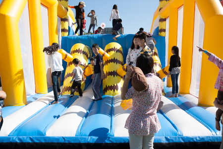 Chiang Mai, Thailand, January 14, 2017: Kids playing at children inflatable playground in Central Festival on January 14, 2017 in Chiang Mai, Thailand.