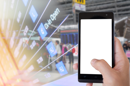 hand hold smartphone with airport blur background,check-in open 免版税图像