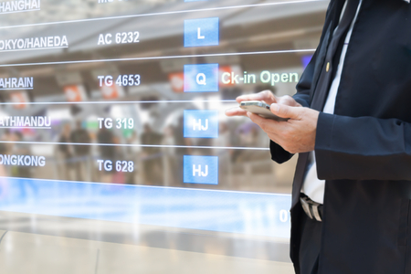 business man use smartphone with airport blur background