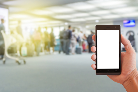 hand hold smartphone with airport blur background