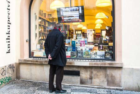 Prague  Chehiya - January 2 2018: On the winery of the bookstore there are many different books. The man looks at the books with interest