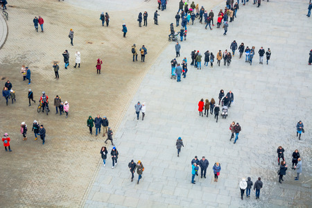 City central square. A lot of people are walking and talking on it. Photographing was carried out from above.