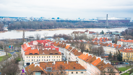 Panoramic view of Warsaw. The transport highway is directed to the bridge over the Vistula River. In the background is a modern view of the city Редакционное