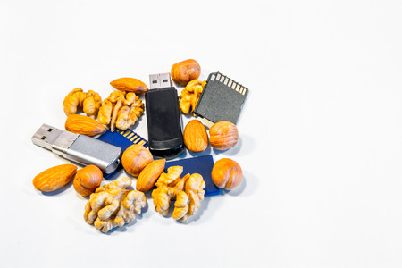 Composition of nuts and memory cards. Symbolizes the useful properties of nuts to improve human memory. Stock Photo