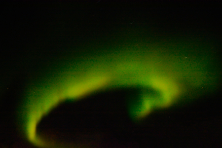 Polar lights in the night sky. Multicolored auroras of various shapes. Night shooting. Stock Photo