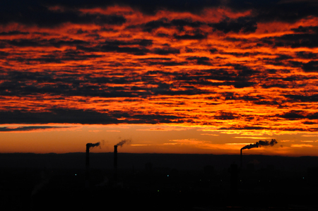 carbondioxide: Dawn over St. Petersburg. Autumn. Smoking power plant chimney over a town.