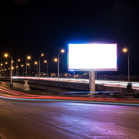 A large Billboard on the background of night lights lamps Stock Photo