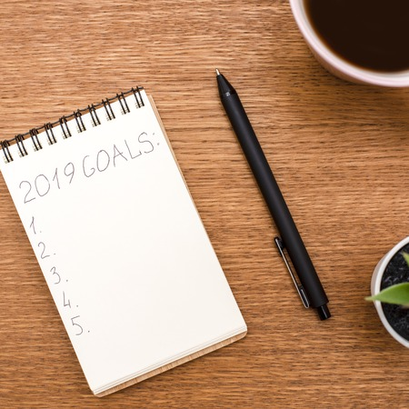 The view from the top. Notebook, coffee, goals for 2019 Stock Photo