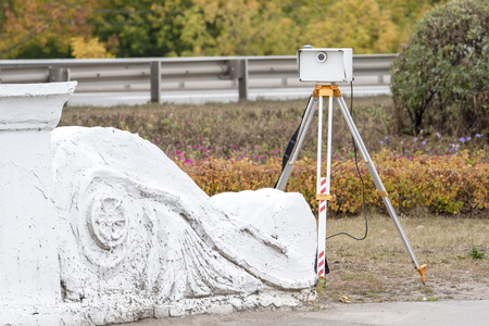 Portable radar on three legs to measure the speed of cars and identify violators