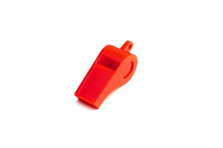 Red sports whistle for signal isolated on white background