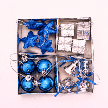 Christmas toys blue and silver to decorate the Christmas tree in a silver box