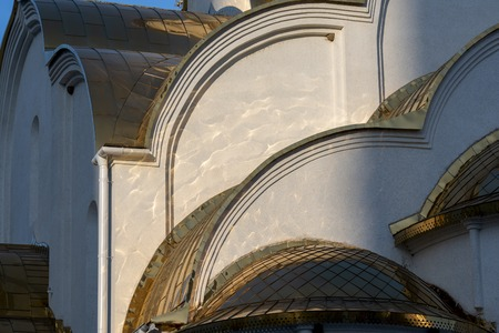 Reflection on the white wall from the Golden domes of the Church on a clear Sunny day 写真素材