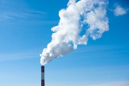 From brick round big chimney smoke comes
