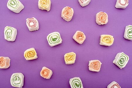 Turkish sweets of different colors on purple background