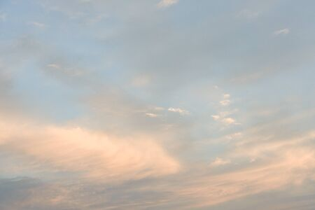 Beautiful clouds on sky in evening summer sunset