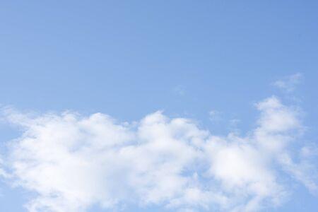 Beautiful fluffy white clouds on blue clear sky Zdjęcie Seryjne