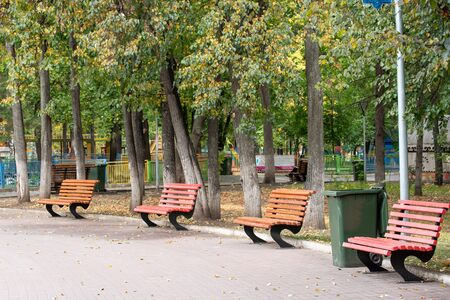 City well-groomed Park with benches , flowers and sidewalk