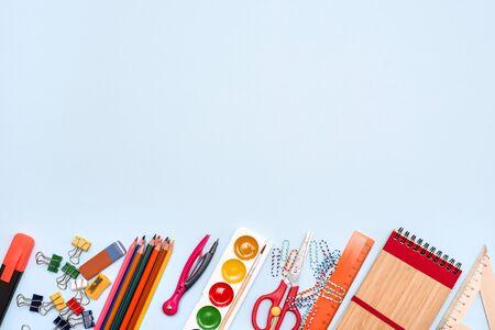 School supplies on blue board background. Back to school concept Zdjęcie Seryjne
