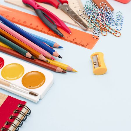 Back to school. Items for the school on blue background