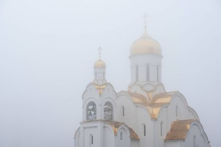 Orthodox Church with Golden domes during the fog