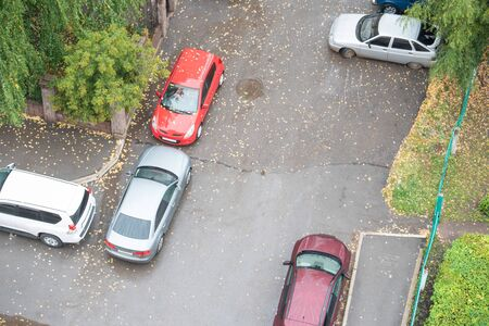 Cars on urban yard in autumn day. Top view