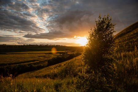 Summer sunset plain landscape. The horizon, the sun at sunset, the rays. Russia. Bashkortostan. Reklamní fotografie