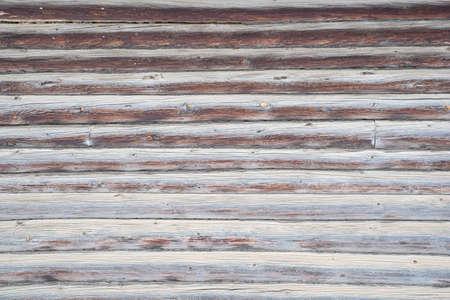 Wooden brown old vintage background. Horizontal logs.