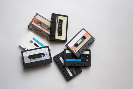 Retro audio cassette tapes isolated on white background from a high angle view