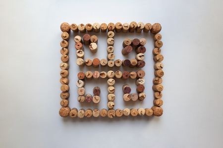 Wine corks meander symbol, also known as Greek key, isolated on white background from a high angle view