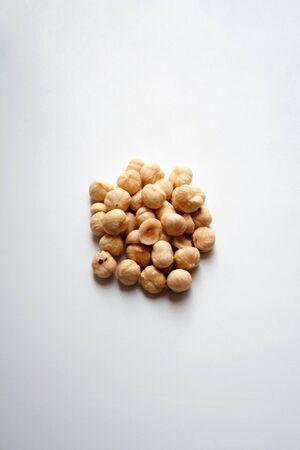 Heap of hazelnuts isolated on white background