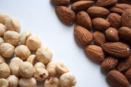 Hazelnut and almond nuts on white background closeup 写真素材 - 131918469