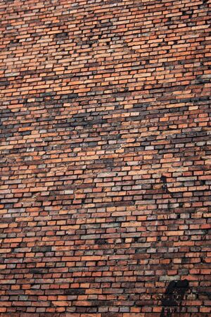 Red brick building wall in Krakow old town, Poland