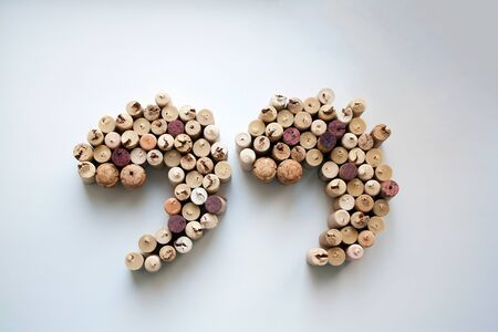 Wine corks quotation marks silhouette isolated on white from a high angle view