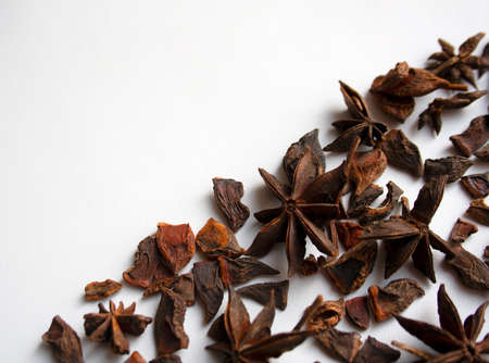 Star anise spices diagonal composition on white background
