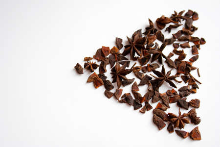Star anise spices triangle shaped composition isolated on white background