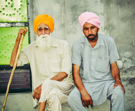 two people of punjab sitting together.
