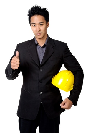 young foreman or engineer with yellow hard hat in suit isolated photo