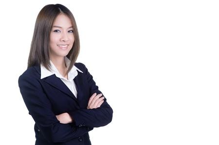 empleado de oficina: Empresaria atractiva con sus brazos cruzados en traje aislado Foto de archivo